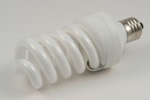 white fluorescent bulb spiral form on white background