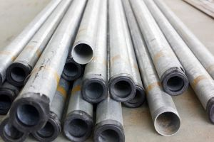 Stock of steel or iron pipes on construction