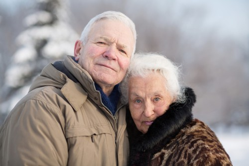 Gentle portrait of an elderly couple in winter